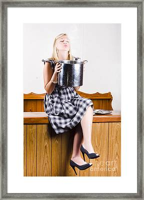 Woman Holding Hot Cooking Pot In Kitchen Framed Print