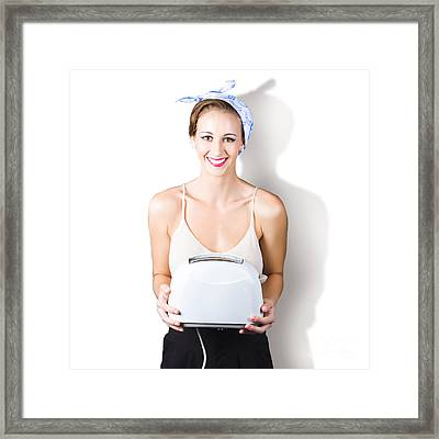 Woman Holding Toaster Framed Print by Jorgo Photography - Wall Art Gallery