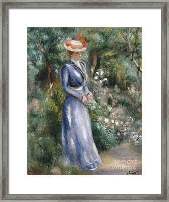 Woman In A Blue Dress Standing In The Garden At Saint-cloud Framed Print by Pierre Auguste Renoir