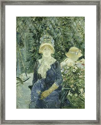 Woman In A Garden Framed Print by Berthe Morisot