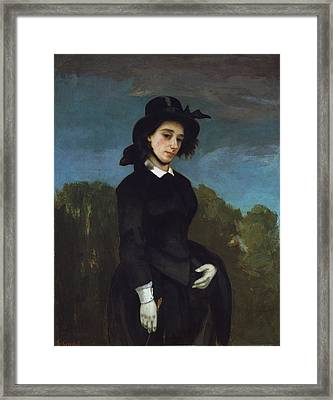 Woman In A Riding Habit Framed Print
