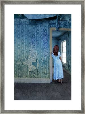 Woman In Abandoned House Framed Print