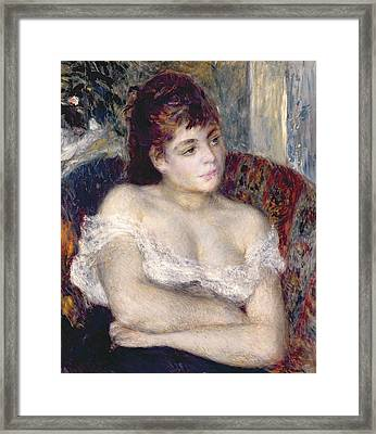 Woman In An Armchair Framed Print by Pierre Auguste Renoir