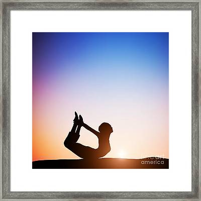 Woman In Bow Yoga Pose Meditating At Sunset Framed Print