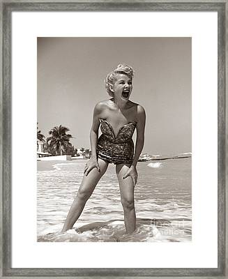 Woman In Fashionable Bathing Suit Framed Print by H. Armstrong Roberts/ClassicStock