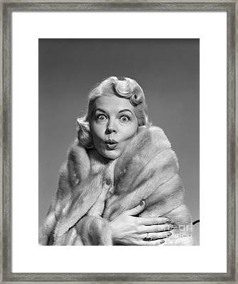 Woman In Fur With Surprised Look Framed Print