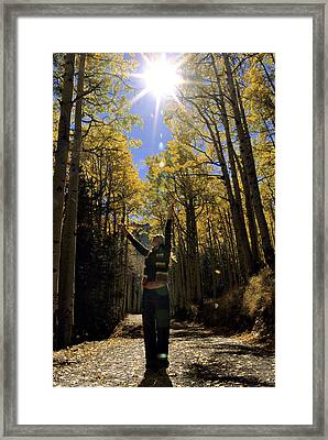 Woman In The Falling Leaves Framed Print by Dawn Kish