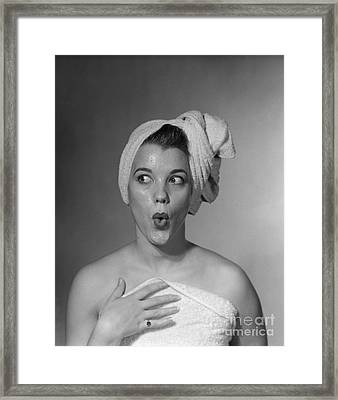 Woman In Towel Looking To The Side Framed Print by Debrocke/ClassicStock