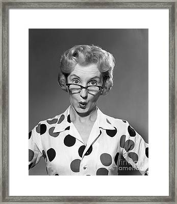 Woman Looking Over Her Glasses Framed Print by Debrocke/ClassicStock
