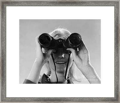 Woman Looking Through Binoculars Framed Print by H. Armstrong Roberts/ClassicStock