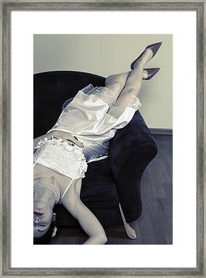 Woman Lying On Chair Framed Print