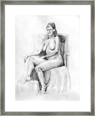 Woman On Chair Framed Print