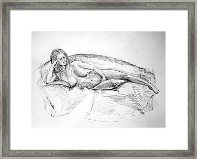 Woman On Couch Framed Print