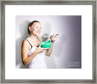 Woman On Diet Eating Bowl Of Cereal With Yogurt Framed Print