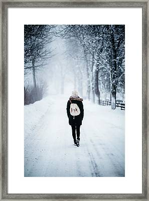 Woman On Path With Spooky Trees In Winter Framed Print