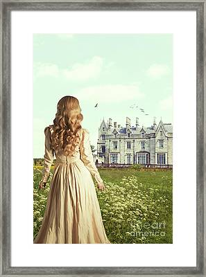 Woman Overlooking Mansion Framed Print