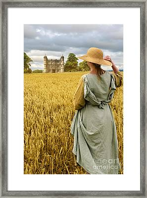Woman Overlooking Wheat Field Framed Print by Amanda Elwell