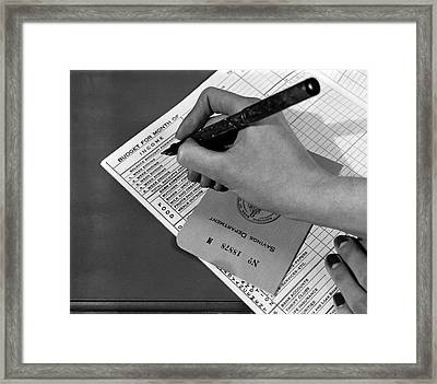 Woman Planning Monthly Budget Framed Print by Underwood Archives