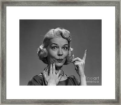 Woman Pointing Upwards With Lips Framed Print
