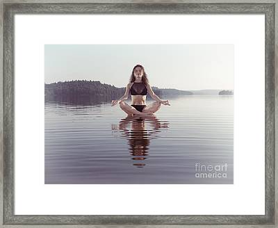 Woman Practicing Still Sitting Meditating On Platform In The Wat Framed Print