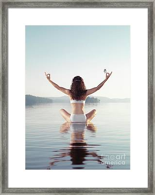 Woman Practicing Yoga Meditation On The Water With Butterfly On  Framed Print