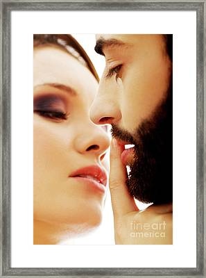 Woman Putting Her Finger On Man's Lips Framed Print