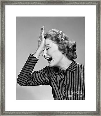 Woman Putting Palm To Forehead, C.1950s Framed Print by Debrocke/ClassicStock