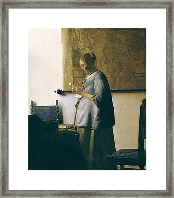 Woman Reading A Letter Framed Print by Jan Vermeer