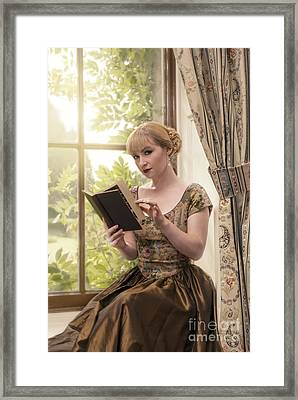 Woman Reading Framed Print by Amanda Elwell