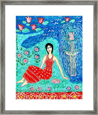 Woman Reading Beside Fountain Framed Print by Sushila Burgess