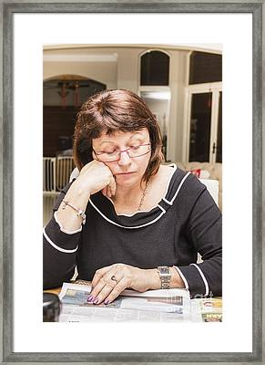 Woman Reading The Daily Newspaper Framed Print