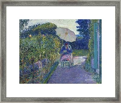 Woman Seated In A Garden Framed Print