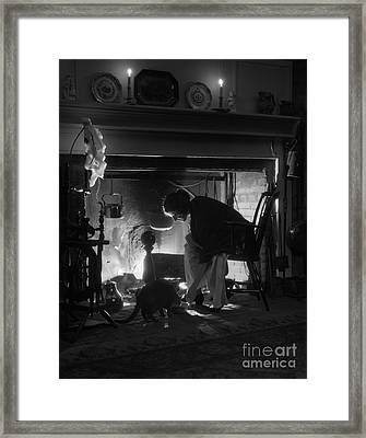 Woman Sitting By Fireplace, C.1920s Framed Print by H. Armstrong Roberts/ClassicStock