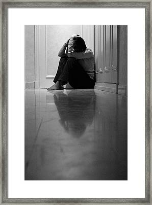Woman Sitting In Corridor With Head In Hands Framed Print by Sami Sarkis