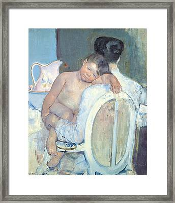 Woman Sitting With A Child In Her Arms Framed Print by Mary Cassatt