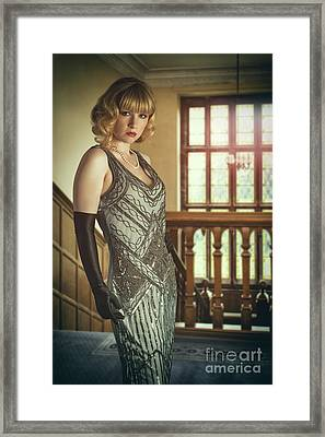 Woman Standing On Balcony Framed Print by Amanda Elwell