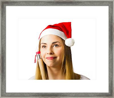 Woman Thinking About Christmas Wish List Framed Print