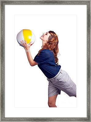 Woman Throwing Beach Ball On White Background Framed Print