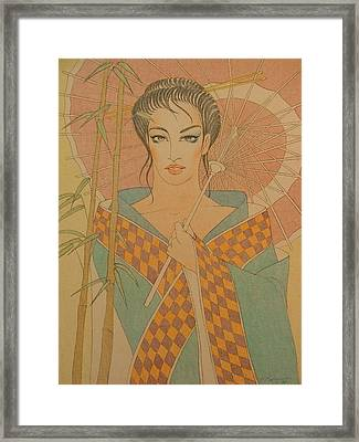 Woman Under The Bamboo Umbrella Framed Print by Gary Kaemmer
