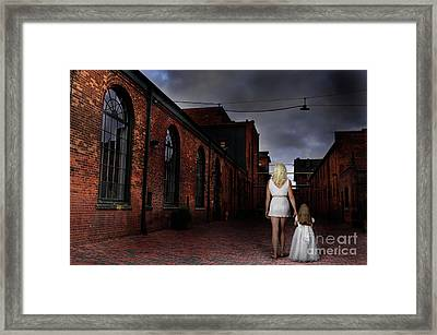 Woman Walking Away With A Child Framed Print by Oleksiy Maksymenko