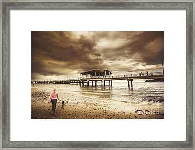 Woman Walking Dog On Stormy Beach Framed Print