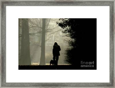 Framed Print featuring the photograph Woman Walking Dog by Patricia Hofmeester