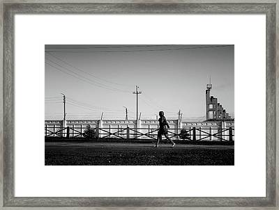 Framed Print featuring the photograph Woman Walking In Industry by John Williams