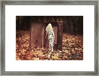 Woman Walking Into Suitcase Framed Print