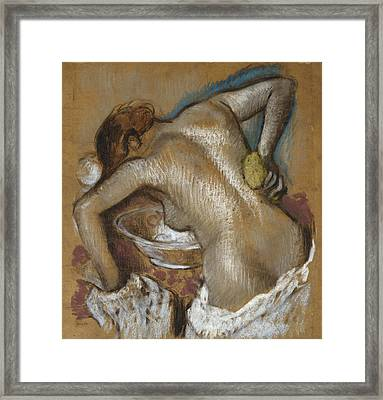Woman Washing Her Back With A Sponge Framed Print by Edgar Degas