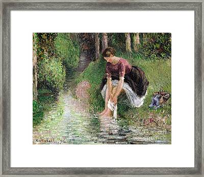 Woman Washing Her Feet In A Brook Framed Print by Camille Pissarro