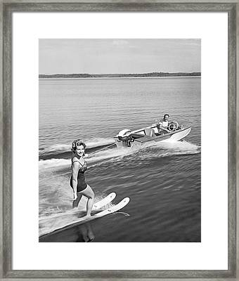 Woman Water Skiing Framed Print by Underwood Archives