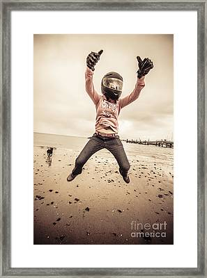 Woman Wearing Helmet And Gloves Jumping On Beach Framed Print by Jorgo Photography - Wall Art Gallery