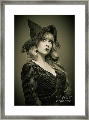 Woman Wearing Witches Hat Framed Print