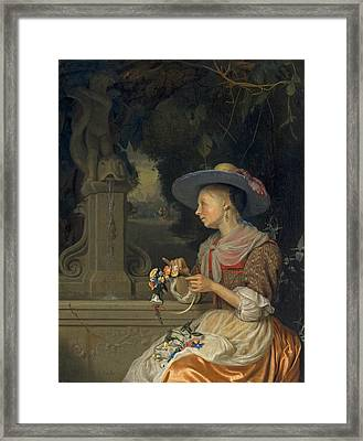 Woman Weaving A Crown Of Flowers Framed Print